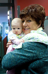 "Zdenka Cerar with her grandchild Neza at presentation of a new book of one of the best Slovenian gymnast Miro Cerar named ""Miroslav Cerar in njegov cas - Miroslav Cerar and his time"" at his 70 years anniversary, on October 30, 2009, in Hotel Mons, Ljubljana, Slovenia.   (Photo by Vid Ponikvar / Sportida)"