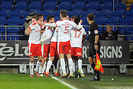 Barnsley players celebrate after Ryan Williams (in centre of huddle) scores his teams 4th goal and late winner. EFL Skybet championship match, Cardiff city v Barnsley at the Cardiff city stadium in Cardiff, South Wales on Saturday 17th December 2016.<br /> pic by Carl Robertson, Andrew Orchard sports photography.