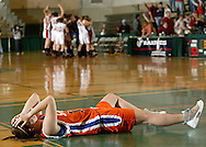 S.S. Seward's Alina Greiser holds her head as Hammond players celebrate in the background after Hammond defeated Seward 52-51 in the Class D state championship game at Hudson Valley Community College in Troy on March 18, 2007.
