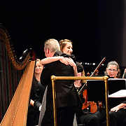 Harpist Anna DeLoi performs with the Portsmouth Symphony Orchestra at the PARMA Music Festival Main Event concert, Saturday, August 17, 2013, at the Music Hall in Portsmouth, NH