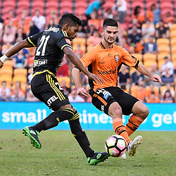 BRISBANE, AUSTRALIA - APRIL 16: Roy Krishna of the Phoenix is tackled by Cameron Crestani of the Roar during the round 27 Hyundai A-League match between the Brisbane Roar and Wellington Phoenix at Suncorp Stadium on April 16, 2017 in Brisbane, Australia. (Photo by Patrick Kearney/Brisbane Roar)