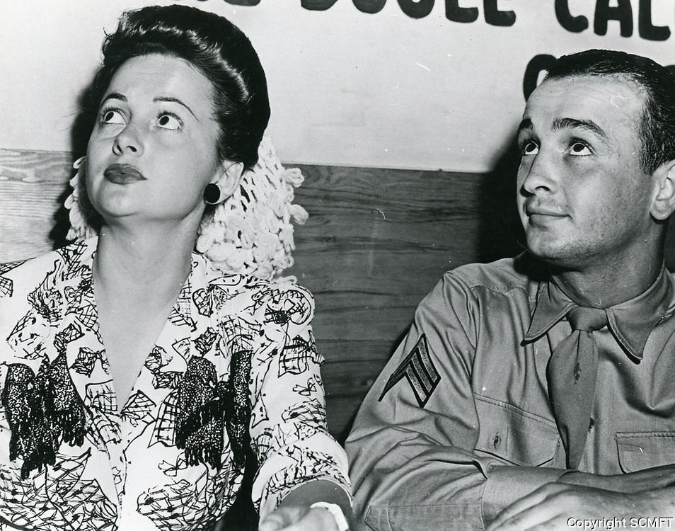 1944 Olivia de Havilland and serviceman at the Hollywood Canteen