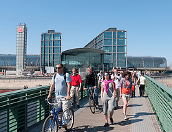 Busy footbridge across Spree River beside Berlin Hauptbahnhof or Main railway station in Germany