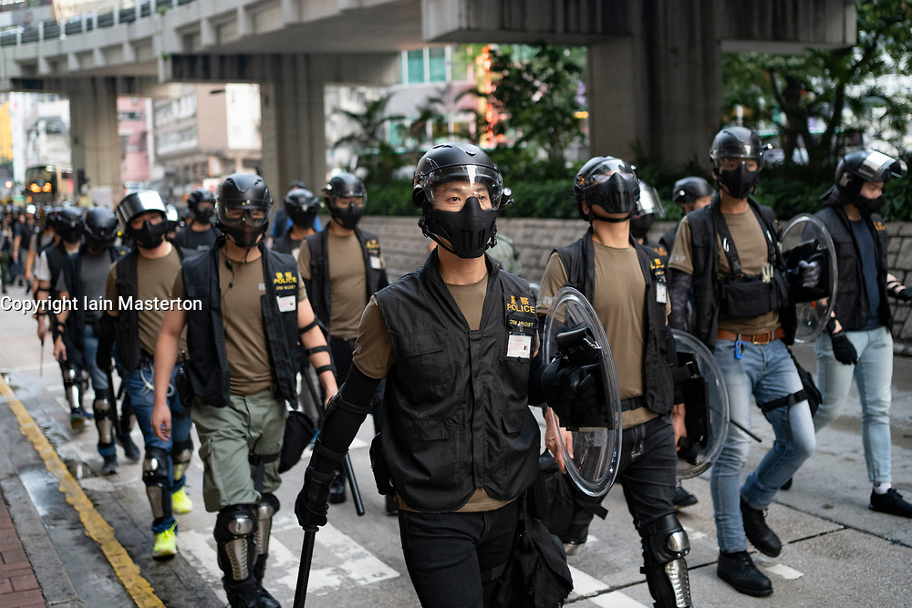 Hong Kong, China. 12th October 2019. Peaceful Pro-democracy march from tourist district of Tsim Sha Tsui along busy Nathan Road to Sham Shui Po Park in Kowloon. Some minor acts of vandalism to property were recorded but most marchers acted peacefully. Evening saw vigil at shrine at Prince Edward MTR  for protestor who died in police custody. Police on street in show of strength and to repair minor acts of vandalism, Iain Masterton/Alamy Live News.