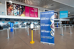 Very quiet check in desks operated by Ryanair at Prestwick Airport in Ayrshire, Scotland, UK