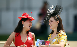Female racegoers enjoy a laugh during day three of Royal Ascot at Ascot Racecourse.