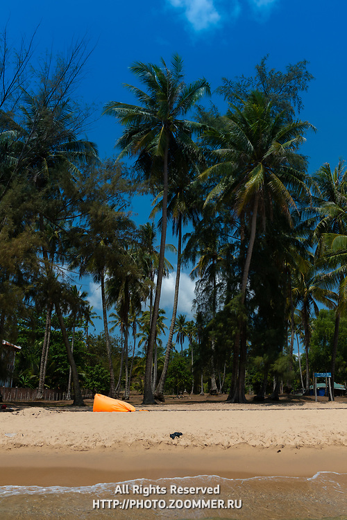 Palms and empty Ong Lang Beach, Phuquoc, Vietnam