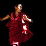 A monk training dances for spiritual festivals in Trongsa Dzong, Trongsa, Bhutan, Asia