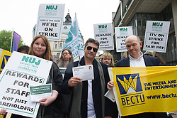 © London News Pictures. 14/05/15. London, UK. A Simon Cowell look a like joins members of BECTU and the NUJ as they protest outside the ITV AGM in a dispute over pay, Queen Elizabeth II Centre, Westminster, Central London. Photo credit: Laura Lean/LNP