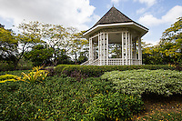 Bandstand at  Singapore Botanic Garden - Singapore Botanic Garden Bandstand - The octagonal gazebo was erected in 1930.  Although no longer used for music performances, it is a favorite wedding photo opportunity spot.  The bandstand is also icon and symbol of the Garden. Singapore Botanic Garden is  a major visitor attraction in Singapore boasting an array of botanical & horticultural offerings with a rich plant collection of worldwide significance. Enhancing these resources are recreational facilities, educational displays and events for visitors surrounded by nature. The garden was first set up by Stamford Raffles, who was the founder of Singapore as well as being a naturalist at Fort Canning.  The original venue closed in 1829 and moved to the present site in 1859. In 2015 the Gardens received inscription as UNESCO World Heritage Site.