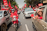 """Mar. 27, 2010 - BANGKOK, THAILAND: Red Shirts march through the streets of Bangkok Saturday, March 27. More than 80,000 members of the United Front of Democracy Against Dictatorship (UDD), also known as the """"Red Shirts"""" and their supporters marched through central Bangkok March 27 during a series of protests against and demand the resignation of current Thai Prime Minister Abhisit Vejjajiva and his government. The protest is a continuation of protests the Red Shirts have been holding across Thailand. They support former Prime Minister Thaksin Shinawatra, who was deposed in a coup in 2006 and went into exile rather than go to prison after being convicted on corruption charges. Thaksin is still enormously popular in rural Thailand.    PHOTO BY JACK KURTZ"""