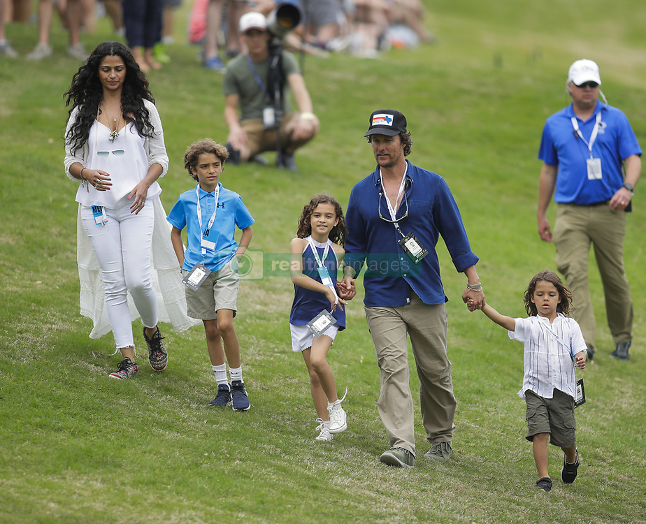 March 25, 2018 - Austin, TX, USA - AUSTIN, TX - MARCH 25, 2018 - Actor Matthew McConaughey and his family walk down the fairway during the final round of the WGC - Dell Technologies Match Play golf tournament at Austin Country Club. From left, wife Camila Alves, son Levi, daughter Vida, and son Livingston. (Credit Image: © Erich Schlegel via ZUMA Wire)