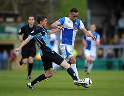 Bristol Rovers' Kaid Mohamed is tackled by Wycombe Wanderers' Dan Rowe - Photo mandatory by-line: Dougie Allward/JMP - Mobile: 07966 386802 26/04/2014 - SPORT - FOOTBALL - High Wycombe - Adams Park - Wycombe Wanderers v Bristol Rovers - Sky Bet League Two