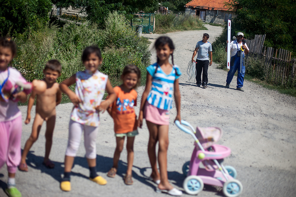 Children posing for a picture at the main road in the village of Rankovce, in the back people coming back from the construction side. Rankovce is located about 30 km from Kosice and has all together 788 inhabitants. About 80% of them are of Roma ethnicity (629). The overall unemployment rate is about 75%, and estimated about 99% in between the Roma community. The foundation ETP Slovakia has a project in Rankovce setting up micro-loan funds for the local Roma community.