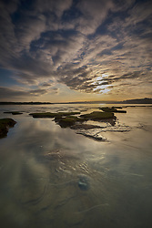 The sun rises over a rising tide on the Skern mudflats at Appledore in Devon.