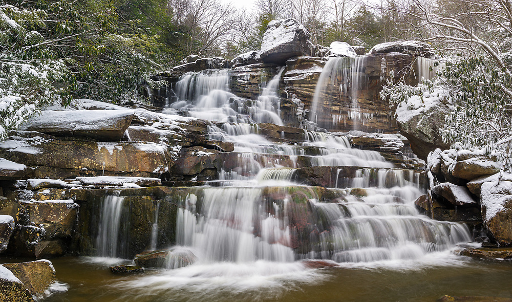 Pendleton run flows over the tall, stratified rock wall on its way to the Blackwater River in West Virginia.
