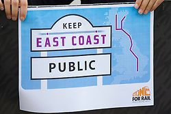© Licensed to London News Pictures. 18/10/2013. London, UK. A protester holds a sign at a protest against the re-privatisation of the United Kingdom's East Coast Line. The East Coast Line, which runs from London to Scotland, is currently the only publicly owned train line after passing to the government from previous operator National Express who encountered financial difficulties. Photo credit: Matt Cetti-Roberts/LNP
