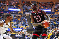 Dec 14, 2019; Morgantown, WV, USA; Nicholls State Colonels forward Elvis Harvey Jr. (23) looks to make a move along the baseline while defended by West Virginia Mountaineers forward Derek Culver (1) during the first half at WVU Coliseum. Mandatory Credit: Ben Queen-USA TODAY Sports