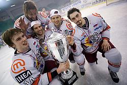Ziga Jeglic of Acroni Jesenice, Anze Terlikar of Acroni Jesenice, Marjan Manfreda of Acroni Jesenice, Miha Brus of Acroni Jesenice and Klemen Pretnar of Acroni Jesenice celebrate with a Trophy  at 6th Round of ice-hockey Slovenian National Championships match between HDD Tilia Olimpija and HK Acroni Jesenice, on April 2, 2010, Hala Tivoli, Ljubljana, Slovenia.  Acroni Jesenice won 3:2 after overtime and became Slovenian National Champion 2010. (Photo by Vid Ponikvar / Sportida)