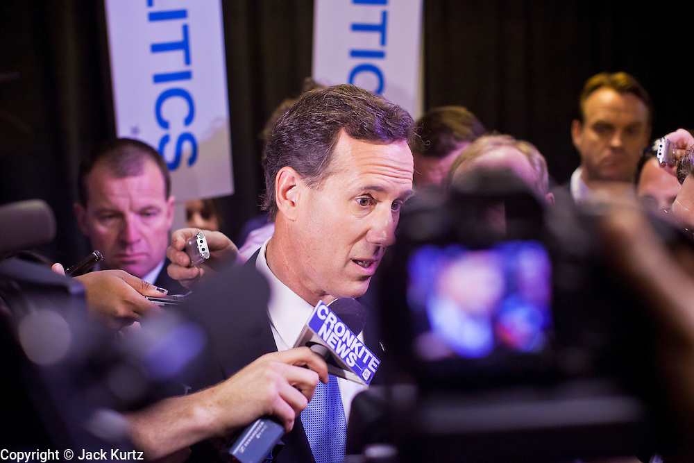 """22 FEBRUARY 2012 - MESA, AZ:   Senator RICK SANTORUM talks to reporters in the """"Spin Room"""" to talk about his performance in the Arizona Republican Presidential Debate in Mesa, AZ, Wednesday. The candidates and their representatives visited the """"Spin Room"""" after the debate to discuss how well their candidates did in the two hour debate, the last one before the Arizona and Michigan primaries next week and """"Super Tuesday"""" on March 6.     PHOTO BY JACK KURTZ"""