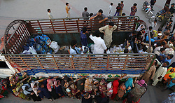 A large number of faithful Muslims are seen standing in queue to get free food distributed at Historical greater Iqbal Park during Holy Fasting Month of Ramzan in Lahore, Pakistan on May 30, 2017. (Photo by Rana Sajid Hussain/Pacific Press) *** Please Use Credit from Credit Field ***