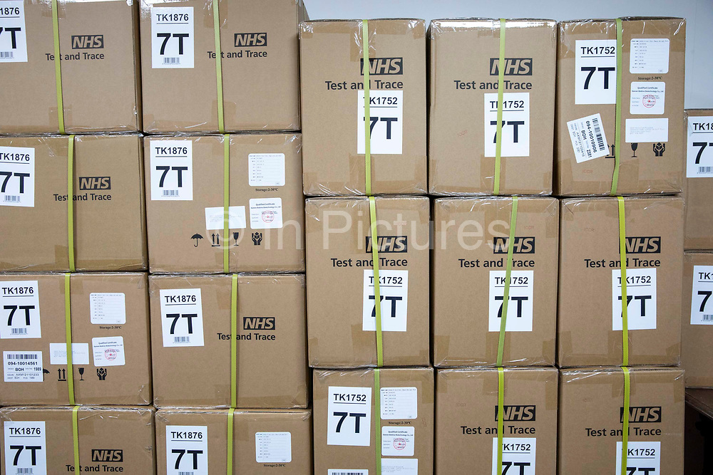 Boxes of NHS Test and Trace COVID-19 Lateral Flow Device LFD kits used for routine home testing when someone is showing no signs of COVID-19. The kits are available for all adults in the UK are are distributed through local testing centres, pharmacy's and community hubs, 28th of April 2021, United Kingdom.