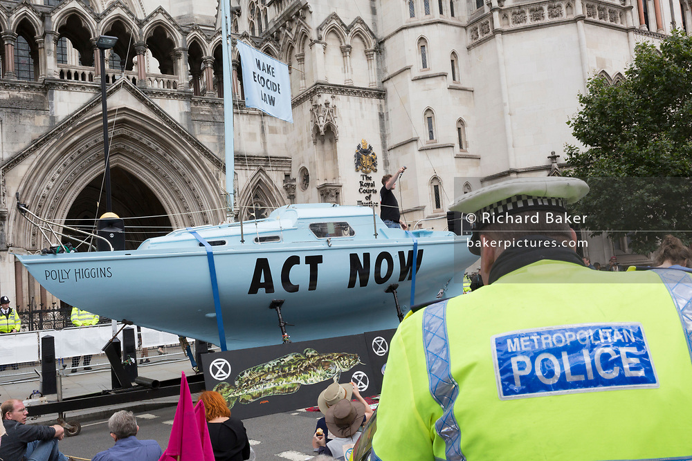 """Environmental and climate change protesters block Fleet Street on the first day of a week-long country-wide protests using using five boats to stop traffic in Cardiff, Glasgow, Bristol, Leeds, and London, on 15th July 2019, in London, England. The yacht in London was named after the late-Barrister and environmental campaigner, Polly Higgins. The group is calling on the government to declare a climate emergency, saying it was beginning a five-day """"summer uprising"""" and that 'Ecocide' ought to be a criminal offence in law."""