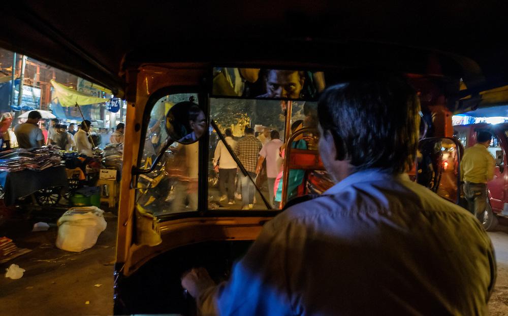 NEW DELHI, INDIA - CIRCA OCTOBER 2016: Tuk Tuk driver in the streets of  Chandni Chowk in Old Delhi.