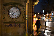 Large barometer outside a pub in Moseley on 12th December 2020 in Birmingham, United Kingdom. A barometer is a scientific instrument that is used to measure air pressure in a certain environment. Pressure tendency can forecast short term changes in the weather.