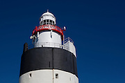 The Hook Lighthouse, Fethard on Sea, Wexford, Ireland is one of the oldest lighthouses in the world, and has been in use since the 12th or 13th century. Although a fire beacon was operated here to warn shipping as early as the 5th century, it was with the arrival of the Normans in that the tower was built. The existing lighthouse incorporates the original Norman fortress structure.
