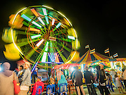 15 JUNE 2105 - NARATHIWAT, NARATHIWAT, THAILAND:  A ferris wheel on the midway at a fair in Narathiwat to celebrate 100 years of Narathiwat. The city has been a Muslim city for centuries, but when Siam (now Thailand) annexed the three southern provinces they changed the name to Narathiwat.     PHOTO BY JACK KURTZ