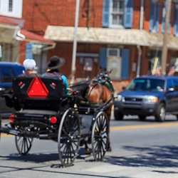 Strasburg, PA – May 29, 2016: An Old Order Amish buggy drives on the main street town street.