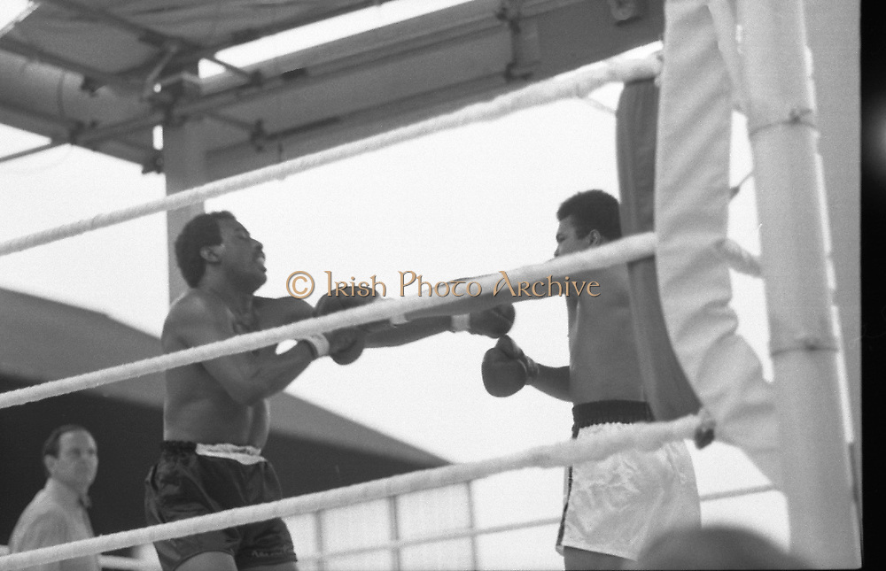 Ali vs Lewis Fight, Croke Park,Dublin.<br /> 1972.<br /> 19.07.1972.<br /> 07.19.1972.<br /> 19th July 1972.<br /> As part of his built up for a World Championship attempt against the current champion, 'Smokin' Joe Frazier,Muhammad Ali fought Al 'Blue' Lewis at Croke Park,Dublin,Ireland. Muhammad Ali won the fight with a TKO when the fight was stopped in the eleventh round.<br /> <br /> Image of a hurt Lewis as he tries to back away from the attacking Ali.