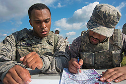 11th Security Forces Squadron response force members Senior Airmen Aaron Legardye, left, and Anthony Poindexter participate in a land navigation exercise during the 11th SFS Defender's Challenge on Joint Base Andrews, Md., Oct. 3, 2018. The challenge tested defender's physically, as well as mentally, in weapons knowledge, urban tactics, land navigation, self-aid buddy care and response to attack. (U.S. Air Force photo by Airman 1st Class Michael S. Murphy)