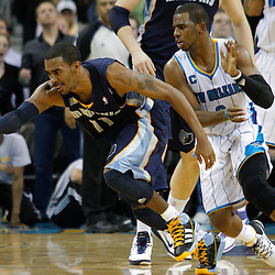 January 19, 2011; New Orleans, LA, USA; Memphis Grizzlies point guard Mike Conley (11) reaches for a loose ball after it was knocked away by New Orleans Hornets point guard Chris Paul (3) during the fourth quarter at the New Orleans Arena. The Hornets defeated the Grizzlies 130-102 in overtime.  Mandatory Credit: Derick E. Hingle