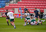London Irish Nick Phipps passes to London Irish Ollie Hoskins during a Gallagher Premiership Round 14 Rugby Union match, Sunday, Mar 21, 2021, in Eccles, United Kingdom. (Steve Flynn/Image of Sport)