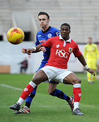 Bristol City's Kieran Agard looks to receive the ball under pressure from Rochdale's Michael Rose - Photo mandatory by-line: Dougie Allward/JMP - Mobile: 07966 386802 - 28/02/2015 - SPORT - football - Bristol - Ashton Gate - Bristol City v Rochdale AFC - Sky Bet League One