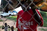 An SLPA soilder with his children at the Juba barracks.