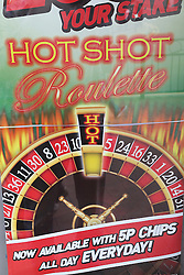 Sign advertising roulette outside amusement arcade