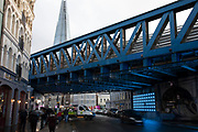 People and traffic pass the light sculpture art installation on Southwark Street on 27th November 2019 in London, England, United Kingdom. Installed underneath a railway bridge this is one of a few large scale artworks in this area.