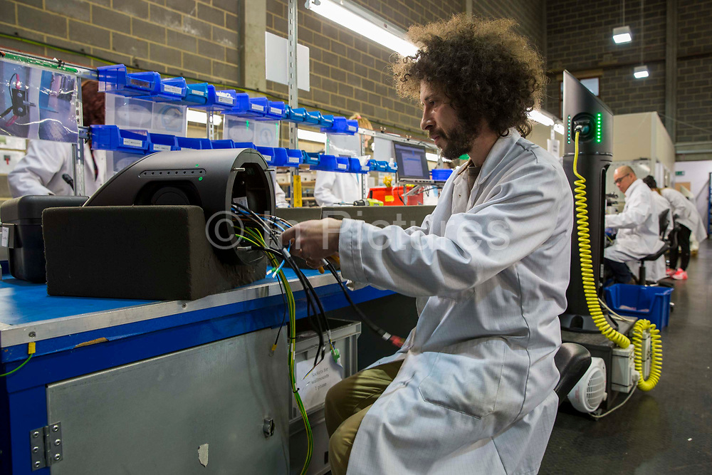Chargemaster technicians building charging points for electric vehicles at their factory in Luton, United Kingdom. Chargemaster make and install the charging points in the UK through their POLAR Network, which gives access to over 6,000 charging points.
