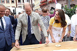 File photo dated 20/07/17 of the Duke and Duchess of Cambridge attempting to make pretzels during a tour of a traditional German market in the central square of Heidelberg, Germany. The Duchess of Cambridge will have spent a decade as an HRH when she and the Duke of Cambridge mark their 10th wedding anniversary on Thursday. Issue date: Wednesday April 28, 2021.
