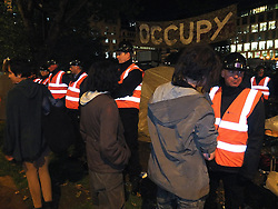 © licensed to London News Pictures. London, UK. 14/07/12. Enforcement officers clear the remaining 'Occupy' protest camp in London's Finsbury Square during the early hours of this morning after Islington Council won a High Court battle over the site. Photo credit: Jules Mattsson/LNP