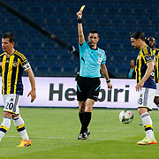 Referee's Ali Palabiyik show the yellow card to Fenerbahce's Emre Belozoglu (L) during their Turkish Super League soccer match Istanbul Basaksehir between Fenerbahce at the Basaksehir Fatih Terim Arena at Basaksehir in Istanbul Turkey on Monday, 25 May 2015. Photo by Aykut AKICI/TURKPIX