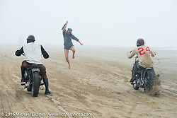 Sara Violette drops the flag as a Harley goes up against the very nimble Go Takamine (Brat Style) on his Indian Chout racer at TROG West - The Race of Gentlemen. Pismo Beach, CA, USA. Saturday October 15, 2016. Photography ©2016 Michael Lichter.