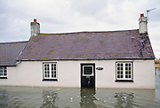 Flood disaster as homes are surrounded by deep flood water at Towyn in North Wales in 1990, UK