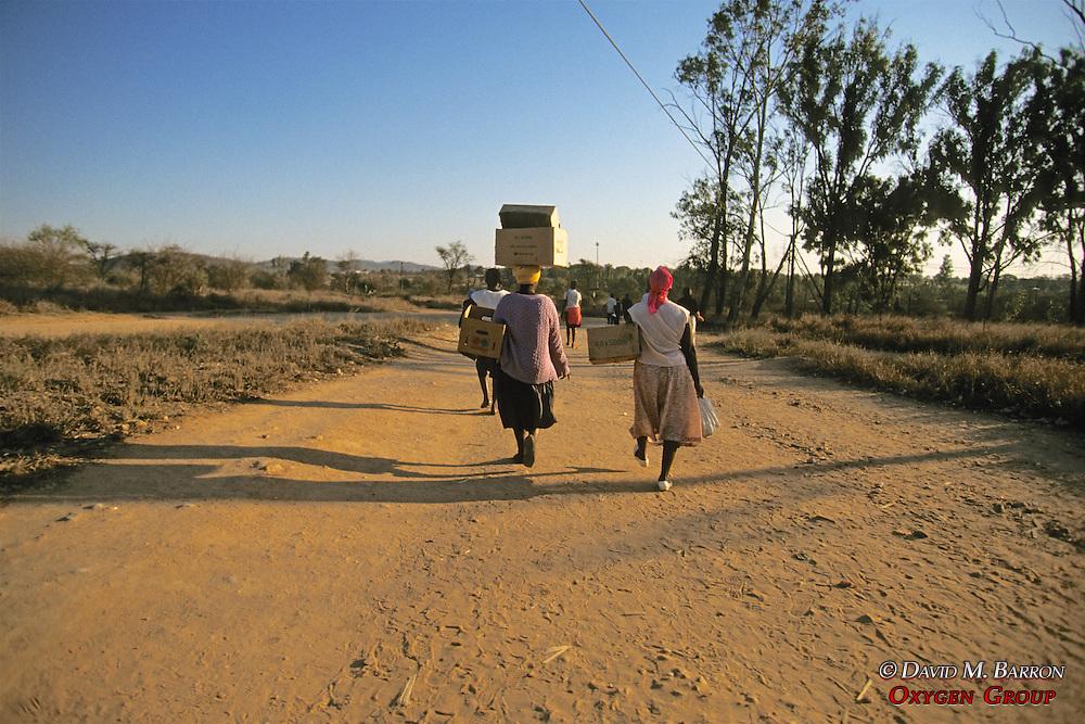 Women Carrying Goods