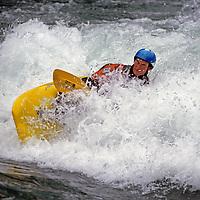 A kayaker paddles in waves on the Kananskis River, near Calgary.