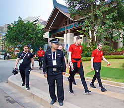 NANNING, CHINA - Monday, March 26, 2018: Local police stand guard as Wales players goalkeeper Wayne Hennessey and Gareth Bale go on a team walk near the Wanda Realm Resort on day seven of the 2018 Gree China Cup International Football Championship ahead of the final against Uruguay. (Pic by David Rawcliffe/Propaganda)