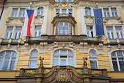 The Czech and EU flags hang outside a building on Old Town Square (Staromestske namesti),  on 18th March, 2018, in Prague, the Czech Republic.